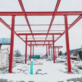 The fuel canopy steel is up! The crew finished installing yesterday before the big snow. This ground up gas station is located in Wheeling behind the Chicago Executive Airport.  . . #gasstation #groundup #fuelcanopy #redsteel #steel #diesel #gasoline #developers #wheelingil #chicagoexecutiveairport #constructionsite #repeatclient #constructionfirm #constructionphotography