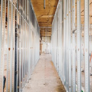 Steel studs, and tall ceilings.  . . #steelstud #steelstudframing #framing #lombardillinois #hallway #commercialrealestate #CRE #investmentproperty #developers #construction #generalcontractor #naturallight #constructionsite #progressphotos #constructionphotography